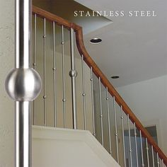 Stainless steel stair balusters provide a high end, quality and elegant staircase. Metal Stair Spindles, Stainless Steel Stair Railing, Banister Rails, Stairs Balusters, Iron Balusters, Banisters, Steel Gate Design, Steel Stairs, Staircase Remodel