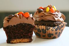 Peanut Butter Cup Chocolate Cupcakes - Reeses cup on bottom & topped w/ Williams Sonoma Chocolate Buttercream Icing