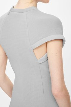 This looks like such a cool, tailored dress with an interesting, understated structured detail!!!