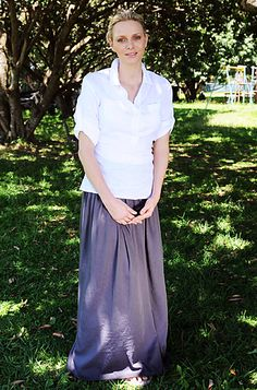 December 9, 2011For a visit to her native South Africa, the royal paired a loose maxi skirt with a white button-down blouse.