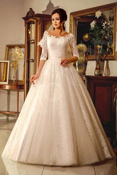 This stunning wedding gown is perfect for those of you in search of something subtle, yet romantic.  Its classic cut highlights your slender figure and the voluminous skirt with a lace overlay has feminine charm. The lace embroidered corset with a scoop neckline is ever so alluring and the elegant satin sash accentuates your slim waistline.  Have all heads turning as you make your way down the aisle in this enchanting gown.  *The price doesn't include accessories.