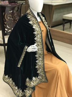Velvet Cape with Golden & Silver Fusion Kashmir Zari Embroidery. This is a very easy to style cape and it can be paired with any top, blouse, dress, or any other thing, no doubt you'll stand out from the crowd. Afghan Clothes, Afghan Dresses, Capes, Velvet Dress Designs, Velvet Shawl, Bridesmaid Shawl, Pakistani Fashion Casual, Velvet Fashion, Antique Clothing