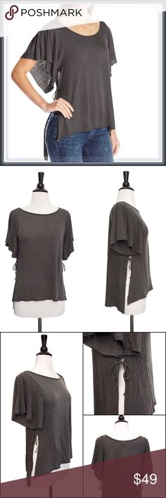 NWT Boho Chic Flutter Side Slit Top ➖NWT ➖SIZE: XS, Small, Medium ➖STYLE: A charcoal slightly loose fitting hi lo top featuring open sleeves and side slits connected by strings tied together. The edges are also raw hemmed for a more boho chic look. Tops Tees - Short Sleeve