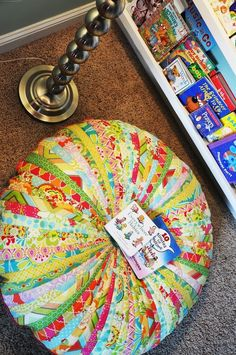 Jammin Jelly Roll Quilt Floor Cushion DIY - Learn how to make a floor cushion to go with your kids room decor or serves as extra seating in your small space.