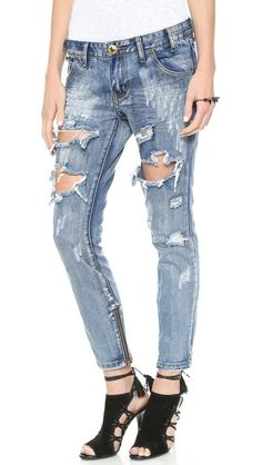 Distressed, skinny, light blue wash - what could be cooler? One Teaspoon Mustang Trashed Jeans.