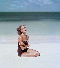 Sunny Harnett stunning on a white sand beach, Vogue, 1953