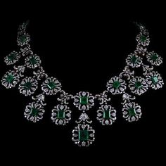 Silver and Gold Emerald Necklace Silver and Gold Emerald Necklace accompanied by carats of Emeralds and carats of Diamonds. Necklace Display, Necklace Set, Lotus Jewelry, Gemstone Jewelry, Silver Necklaces, Jewelry Necklaces, Green Girl, Emerald Necklace, Dramione