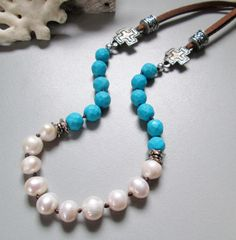 Turguoise Blue Hand Knotted Necklace, Leather, Bohemian beaded Jewelry, Pearls. $42.00, via Etsy.