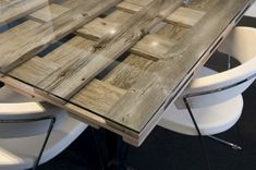 Recycled boardroom table - with white chairs - this looks sharp also.  combining wood & glass