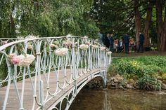 Bridge decorated with pink and white flowers | Photography by http://www.redonblonde.com/