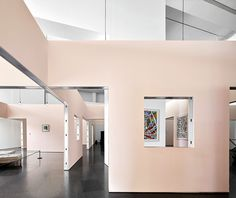 the concept for the exhibition consists in the creation of a grid of rooms within one of the circular spaces of richard meier's building.