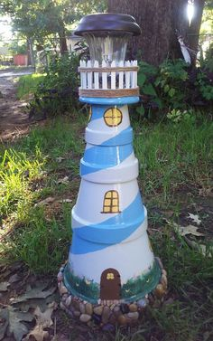Clay pot lighthouse I made... Super easy to make hardest part was figuring out what colors and designs I wanted to put on it lol