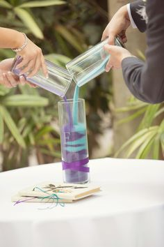 purple & teal theme, sand ceremony - purple on the bride's side, teal on the groom's side