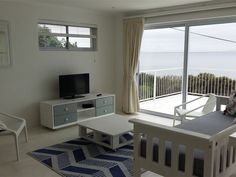 Stunning Simonstown Apartment - This large, stunning Simonstown maisonette is perched on the mountainside with spectacular views over False Bay. The apartment is open-plan with a double bed, a private bathroom (shower only) and a 30 .