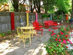 wooden shutters and painted furniture make for a festive patio