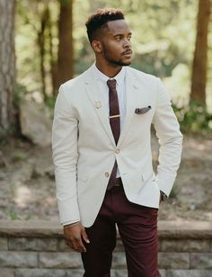 Groom in a cream jacket and burgundy pants