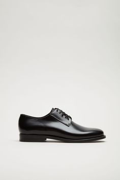 COS image 1 of Lace-up leather shoes in Black