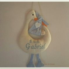 Fiocco nascita cicogna con un benvenuto ricamato in azzurro