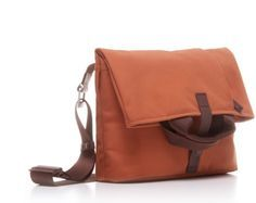 The Postal Bag is a two-in-one bag that can be carried as a small fold-over or expanded into a top-handled tote.