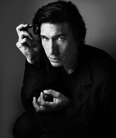 Artistic shot of Adam Driver in black and white