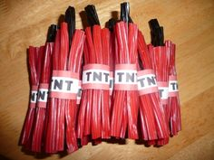 TNT Party Favors. Very easy to make using Strawberry cables and Liquorice cables 7 to 1. The labels mere made using Minecraft printable for TNT party popper labels. #minecraftparty  #minecraftbags
