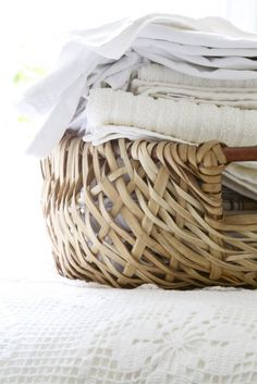 Store guest linens in individual baskets for each room and bathroom.