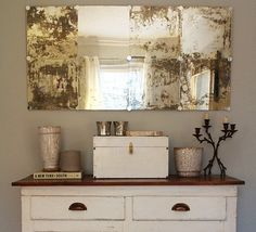 DIY Antiqued Mirror - but I'd use the large builder mirrors that were attached to the bathroom walls - one large mirror would like more authentic than tiled mirrors.