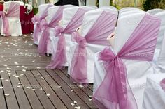 I like how the bows are tied on the side of the chair facing the aisle. I think alternating chairs w/bow and candles would look nice down the aisle.