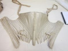 1780s stays for chemise a la reine. Criss-cross straps. Has a good link to another pair in the comments.