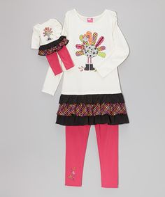 With its girly colors and festive details, this set is full of style. With a bitty version for Dollie too, this is perfect to celebrate the holiday and beyond!Includes tunic, leggings and doll outfitDoll outfit fits 18'' dollBodice / first / third tiers: 60% cotton / 40% polyesterS…