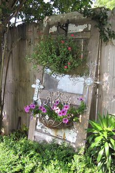 Plants and garden art turn an old door into a focal point.