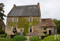A 16th century, monastic manor house and its nave barn in Sarthe's bocage countryside - France mansions for sale - in Sologne, Touraine, Loire valley, Burgundy, Auvergne. - Patrice Besse Castles and Mansions of France is a Paris based real-estate agency specialised in the sale of Manors.