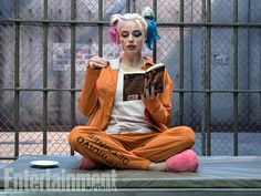 Harley in her prison uniform. Just enjoying herself with a good ol' cup of tea and a book.