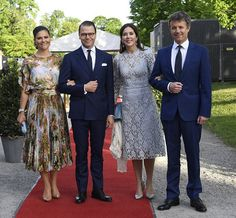 (L) Crown Princess Victoria of Sweden, looked striking in a floral and swan print dress, while Crown Princess Mary of Denmark, opted for a simpler look but equally elegant in blue lace. The ladies were joined by Prince Daniel of Sweden and Crown Prince Frederik of Denmark (right) who both looked dapper in dark blue suits for a dinner at Eric Ericsonhallen at Skeppsholmen in Stockholm