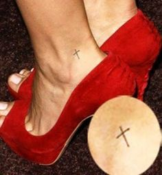 Cross tattoo on foot