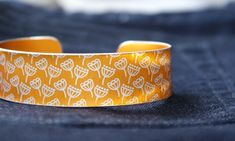 A fun narrow cuff made from anodised aluminium with a mini print of seed heads. I drew this pattern digitally, made it into a resist and applied it to the metal. I then dye the aluminium, seal it and remove the resist which leaves the pattern showing i. Handmade Items, Handmade Gifts, Metal Working, Cuff Bracelets, Seeds, Orange, Trending Outfits, Unique Jewelry, Mini