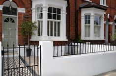 Plastered rendered front garden wall painted white metal wrought iron rail and gate victorian mosaic tile path in black and white scottish pebbles York stone balham london (29)