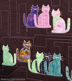 If there are any animals who seem to really love quilts and are curious about them, it has to be cats. Here's a tribute to our feline furba...