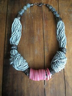 This modern necklace is made with light grey seed beads, light pink tagua nut rings, oxidized metal rings and kiwi jasper.  Length of the necklace is 52