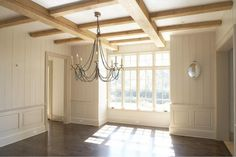 large beams. paneling.  chandy. wainscoting.  window seat nook..... what's not to love?  would remove the distraction of the decorative cross beams and add larger ceiling molding.