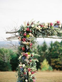 Rustic meets elegant in this amazing floral arch