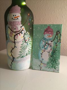 Snowmen decorating tree on canvas and bottle