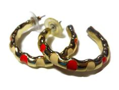 Use code SOCIAL15 for 15% off all purchases over $15, plus FREE shipping on most jewelry! Enamel hoop earrings, gold tone, Alternating red and white blocks of enamel  Put yourself in the Mod Squad with these hoops! They are in thus very good #vintage condition.  ... #etsygifts #vjse2 #jewelry #gift #maggiescornerstore