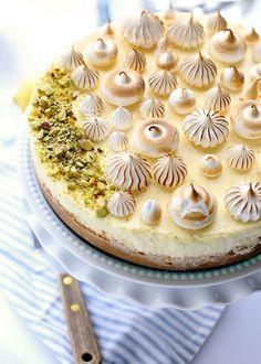 Creamy Lemon Meringue Cheesecake: buttery cookie crust, creamy, tart, spiked lemon filling, and sweet meringue topping. SO good!   TrufflesandTrends.com