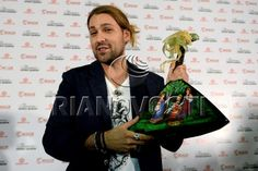 MOSCOW, RUSSIA. NOVEMBER 19, 2013. German violinist David Garrett playing the violin during a press conference ahead of the Russian premiere of The Devil' s Violinist film directed by Bernard Rose.Gift from fan - balalaika, Russian musical insturment