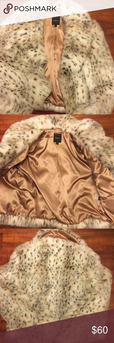 Express faux fur winter jacket FABULOUS 👑💍 Express faux fur jacket, it's BEAUTIFUL 😍 I Love this coat. It is VERY warm. In PERFECT 👌🏼 condition. Size small. 2 front pockets & 1 inside pocket. Fully lined. Express Jackets & Coats