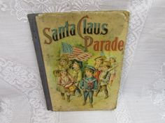 Santa Claus Parade.  This book was copyrighted in 1903 by W.B. Conkey Company of Chicago.  It consists of charming holiday stories for boys and girls.  All of the illustrations are in black and white.  For being over 100 years old, this book is in good condition.  There is a lot of wear and tear to the covers.  They are staining and the edges are damaged.  The pages have yellowed over the years but for the most part are still decent. There are some staining to the pages also. There is ...