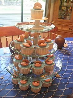 """Under Sea Party- love the """"clam"""" cupcakes & fish net over blue tablecloth"""