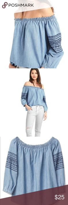 GAP Chambray Embroidered Off the Shoulder Shirt 100% cotton and 100% perfect for fall/summer transition. Absolutely adorable on- I wore it twice and got so many compliments. Easy to style casual with shorts or dress it up with black skinnies. Navy blue embroidery on sleeve. Button closer falls right above wrist and is cute rolled or down. Excellent condition- no signs of wear. Size medium. GAP Tops