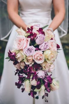 A stunning lilac ivory blush pink and plum roses and orchids wedding bouquet Orchid Bouquet Wedding, Blush Bouquet, Wedding Flower Arrangements, Bride Bouquets, Wedding Centerpieces, Wedding Flowers, Floral Arrangements, Diy Wedding Reception, Plum Wedding